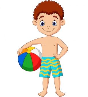 Мультяшный счастливый мальчик держит пляжный мяч