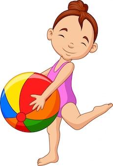 ビーチボールを保持している漫画幸せな女の子