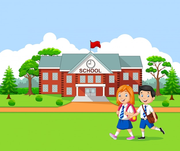 学校に行く幸せな小さな子供たち