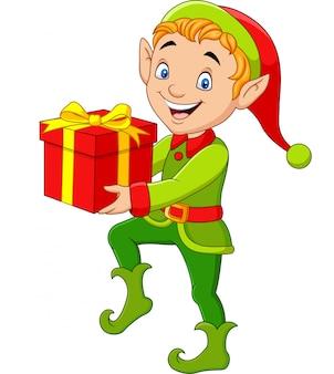 Счастливый зеленый эльф мальчик держит подарки