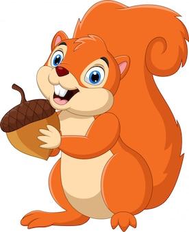 Мультфильм белка держит орех