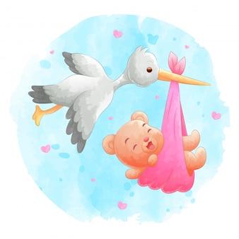 飛んでいる鳥は水彩背景でクマの赤ちゃんをもたらす