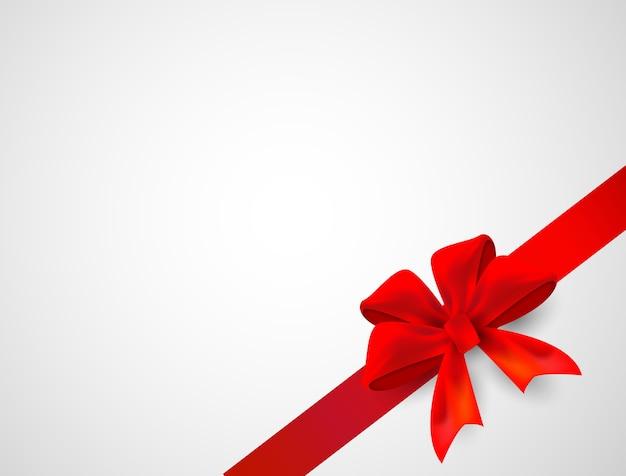 白い背景に弓のお祝いの赤いリボン