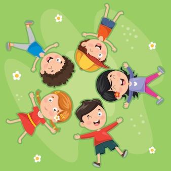 草の上に横たわる子供たち