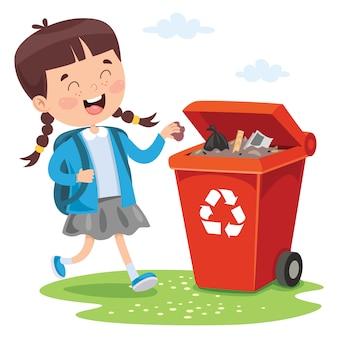 Малыш бросает мусор в мусорное ведро