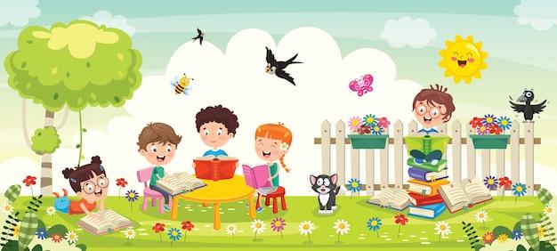 公園で勉強している小さな学校の子供たち