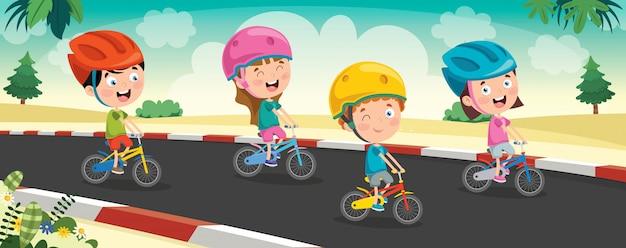 道路上の自転車に乗って幸せな小さな子供たち