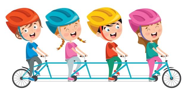 自転車に乗って幸せな小さな子供たち