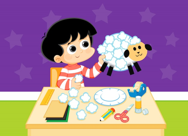 色紙から手作りの羊を作る子