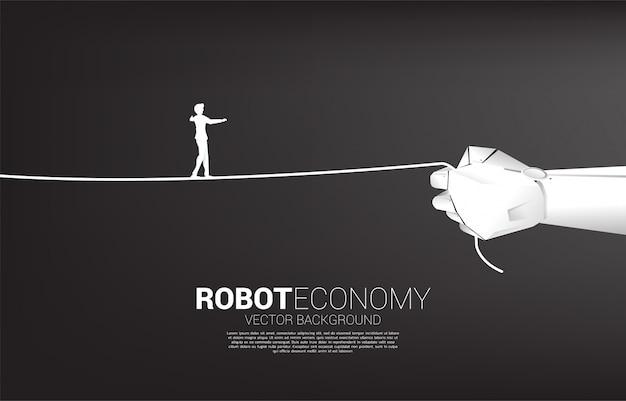 ビジネスマンのシルエットは、ロボットの手でロープを歩きます。ビジネスチャレンジとキャリアパスの概念。