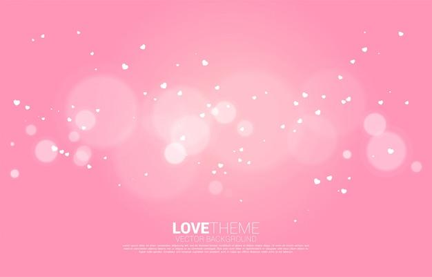 飛行の小さなハートと光のボケ効果の背景。バレンタインデーと愛のテーマ