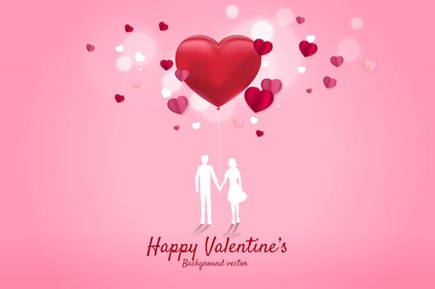 恋人のカップルがハート形風船で手を握って