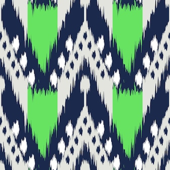 布、カーテン、繊維のデザイン、壁紙、表面のテクスチャの背景としてイカットのシームレスなパターン