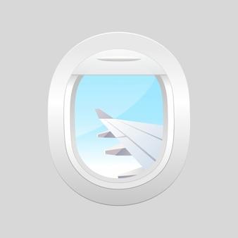 外の曇りの青い空と飛行機の窓。