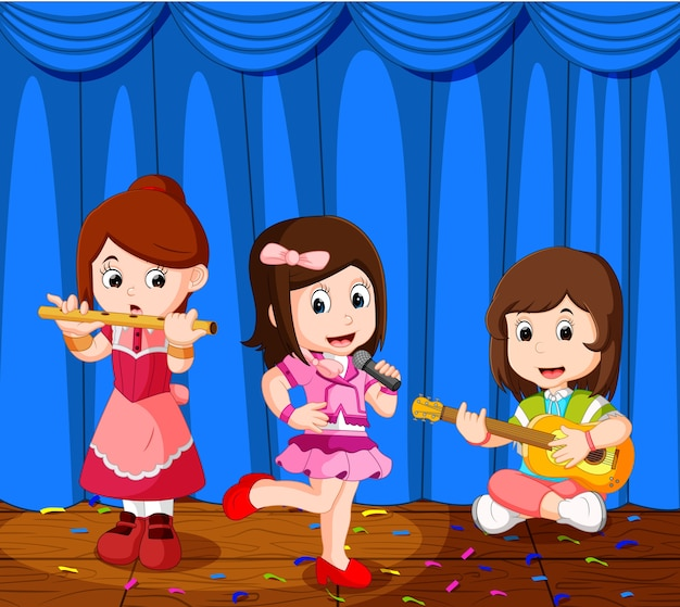 小さな子供たちが音楽バンドで音楽を演奏する