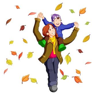 葉で遊んでいる秋に一緒に幸せな家族