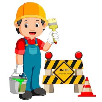 Рабочий со знаком строительства