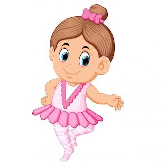 ピンクのドレスでかわいいバレリーナの女の子が踊る