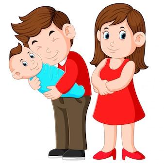 女と男、新生児を保持