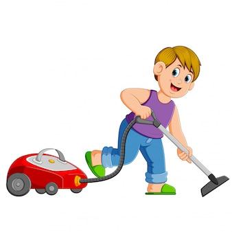 若い男が掃除機で掃除
