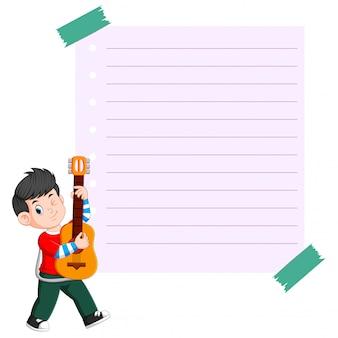 ギターを弾く若い男と紙のテンプレート