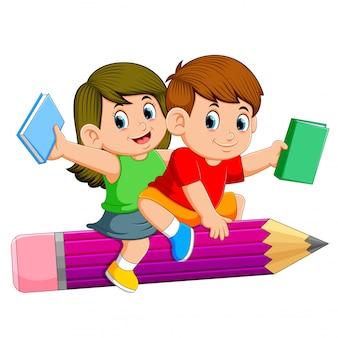 学校の子供たちが鉛筆に乗って