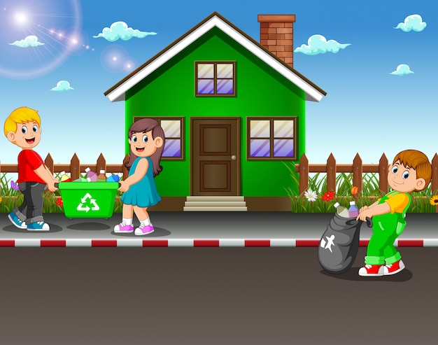 家の通りでゴミを集めるボランティアの子供たち