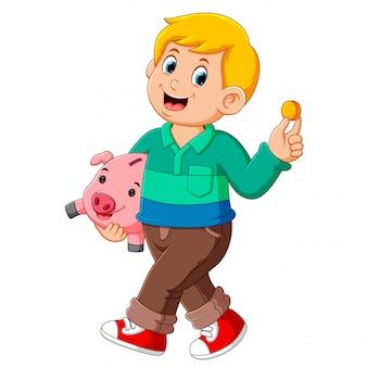 幸せな笑顔と豚の銀行を運ぶ少年