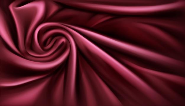 Вихревой тканевый шелковый фон, роскошный бордовый драпированный сложенный текстиль с мягкими спиральными вихревыми атласными волнами