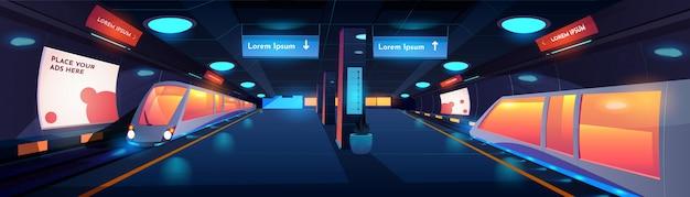 夜の地下鉄駅の内部で電車します。