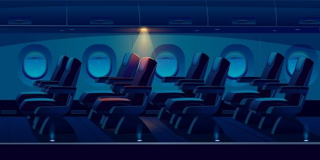 夜の飛行機のキャビン