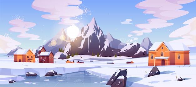 住宅と冬の山の風景