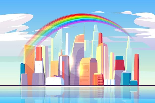 街のスカイラインのアーキテクチャのウォーターフロントの上の虹