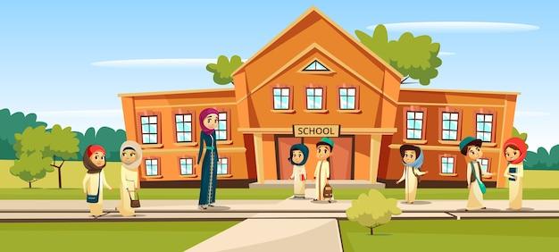 イスラム教徒の学校の子供たちと学校に行く先生。