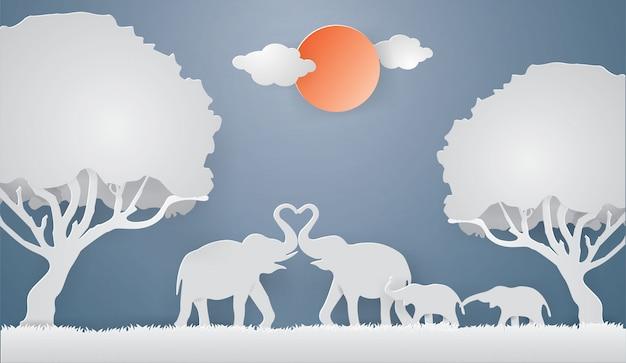 象の家族は春シーズンの背景に灰色の芝生の上の愛を示す