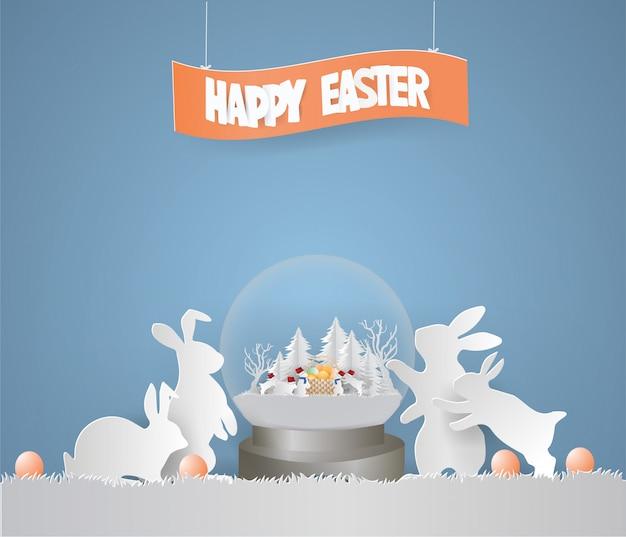 Концепция дня пасхи с кроликом окружила кролика санты в глобусе снега.