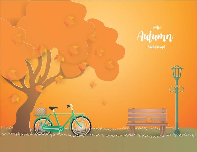 秋の図の木の下で緑の自転車。