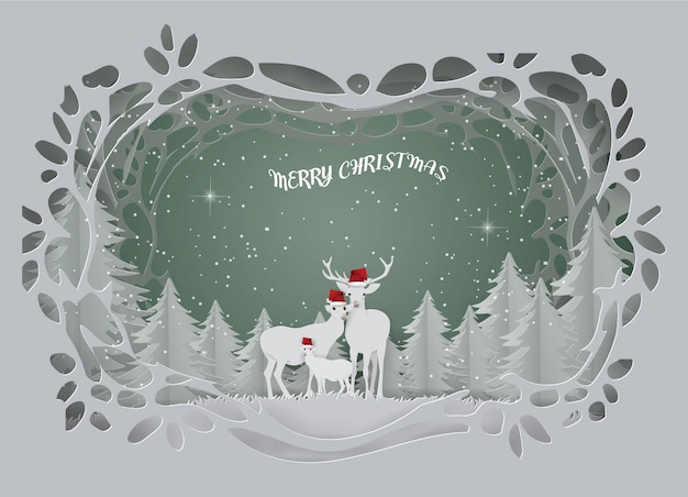 鹿の家族と抽象的な背景カードは、冬の季節に森に住んでいます。