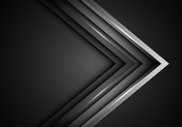 暗い空白スペースの背景に灰色の金属矢印方向。