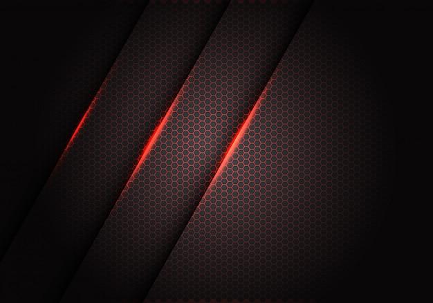 暗い灰色のメタリックな背景の六角形のメッシュパターンに赤い光。