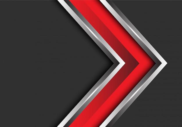 Красное серебряное направление стрелки на серой предпосылке пустого пространства.
