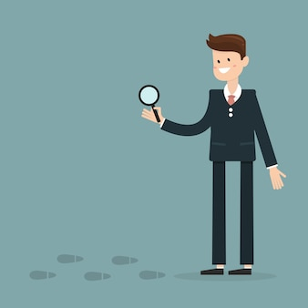 不審な足跡を調査するビジネスマン