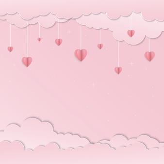 ピンクの空とぶら下がっているピンクのハート紙アート