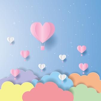 紙にピンクと白のハート熱気球とカラフルな雲カット