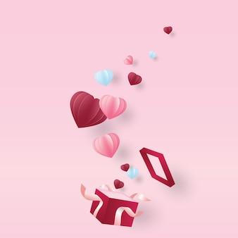 Подарочная коробка с развевающимися сердцами в бумажном вырезе