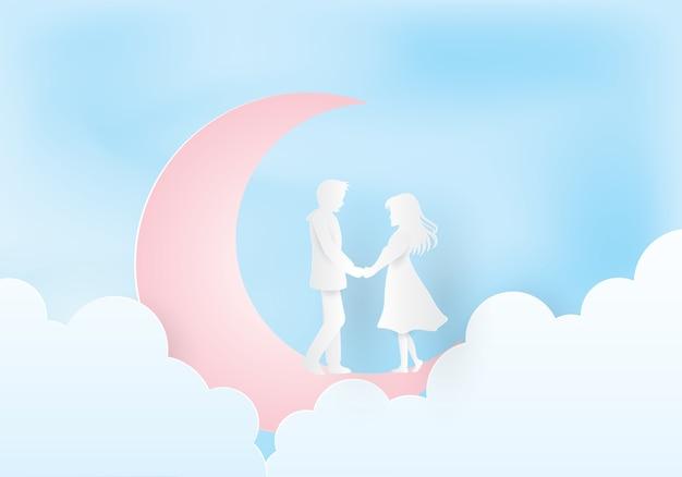 月の下で手を繋いでいるカップル