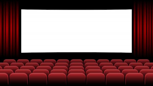 Кинотеатр с пустым экраном и красным сиденьем