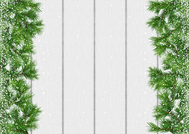 クリスマスの雪で覆われた枝の背景