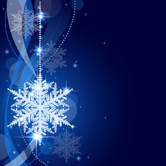 スノーフレークと吊るす冬のクリスマスの背景