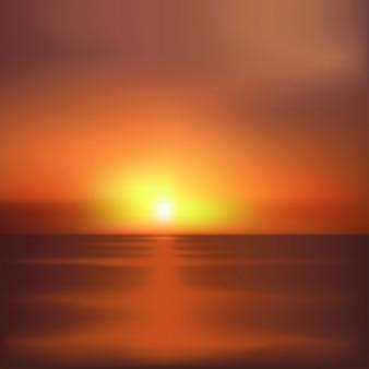 海の背景に沈む夕日